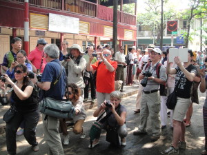 The tourists making a spectacle of the monks, and themselves