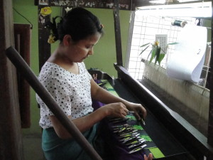 Working the pattern on the hand-woven fabric