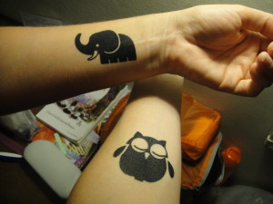 Cute tattoos!  (I have the owl, Ilene has the elephant)