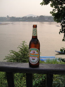 You can tell what country you're in by the beer -- our first Beerlao, on the Mekong (terrace behind the hotel).