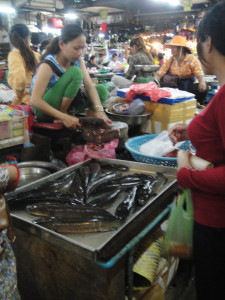 Fish monger.  They're kept alive until purchase.