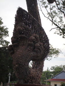 A naga made of old gun parts.  A peace monument.