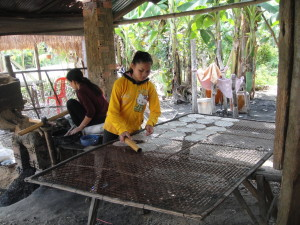 Making rice paper.  So much work, and they sell for $0.50 per 100 sheets.