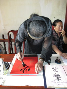 Getting my good luck calligraphy (the symbols for peace and contentment).