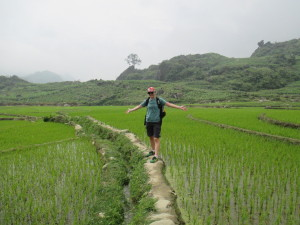 Testing our balance walking through rice fields.